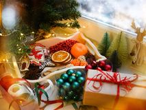 Cozy New Year`s things, gifts in craft paper, tied with a red ribbon royalty free stock image