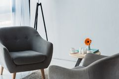 Cozy office in light tones with grey chairs. And table royalty free stock photos