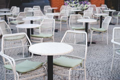 Cozy outdoor cafe with cane chairs Stock Photos