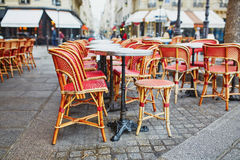 Cozy outdoor cafe in Paris Stock Images