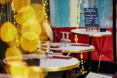 Cozy Parisian outdoor cafe with yellow lights Royalty Free Stock Image