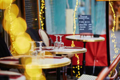 Cozy Parisian outdoor cafe with yellow lights Stock Photos