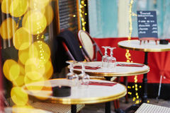 Cozy Parisian outdoor cafe with yellow lights Royalty Free Stock Photography