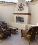 Cozy patio furniture in courtyard Stock Photos