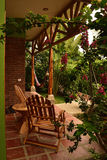 Cozy patio in a garden oasis with bougainvillea Royalty Free Stock Photo