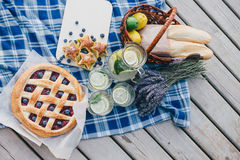Cozy picnic near lake. In summer evening Stock Photo