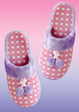Cozy pink slippers. Pair of cozy and warm pink slippers on a colorful background with clipping path royalty free stock photo