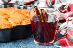 Cozy plaid in fall day with hot alcoholic drink mulled wine stock photo