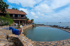 Cozy resort and pool by the sea Stock Photography