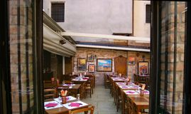 Cozy restaurant. Window shoot of outside restaurant in very narrow streets in venice Stock Photos