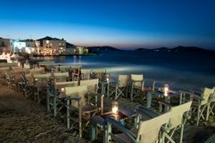 Cozy restaurant at night in Naussa, Paros Royalty Free Stock Photos