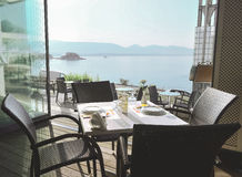 The restaurant on the Greek island. Сozy restaurant with a beautiful view of the sea Royalty Free Stock Images