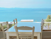 The restaurant on the Greek island. Сozy cafe with a beautiful view of the sea Stock Images