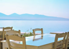 The restaurant on the Greek island. Сozy cafe with a beautiful view of the sea Royalty Free Stock Images