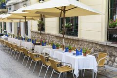 Outdoor restaurant in Barcelona. Cozy restaurant with  tables and chairs Royalty Free Stock Photo