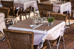 Cozy Restaurant tables ready for service Royalty Free Stock Images