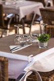Cozy Restaurant tables ready for service Stock Photo