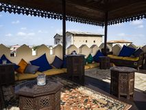 Cozy rooftop, rugs and cushions royalty free stock photo