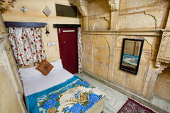 Cozy room with a bed and carpet in historical house Stock Photo