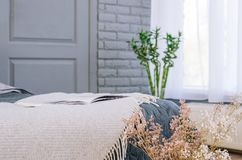 A cozy room with a bed and a large window stock photos