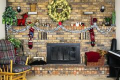 Cozy room with brick fireplace decorated for Christmas, rocking Stock Photo