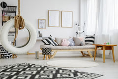 Cozy room of child. Trendy cozy white room of child with fun pillows Royalty Free Stock Photography