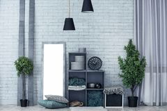 Cozy room interior with shelving unit used Stock Images