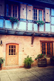 Cozy rustic backyard of traditional timber frame house.  Alsace, Stock Image
