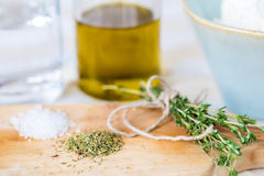 Cozy rustic home kitchen still life, dried herbs thyme, salt. Royalty Free Stock Image
