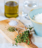 Cozy rustic home kitchen still life, dried herbs thyme, salt. Stock Images