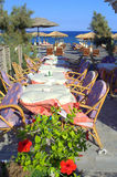 Cozy seaside restaurant and hibiscus ,Santorini,Gr Stock Images