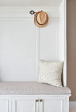 Cozy seat with white frame with striped pillow and panama hat Stock Photos