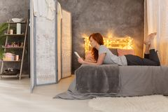 Cozy simple loft. With sleeping space separated by screen stock photography