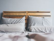 Free Cozy Simple Loft Wooden Bed. Royalty Free Stock Photo - 94226765