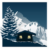 Cozy ski cottage in the snowy mountains Stock Photography