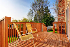 Cozy small backyard with wooden walkout deck Royalty Free Stock Photos