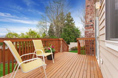Cozy small backyard with wooden walkout deck Stock Photo