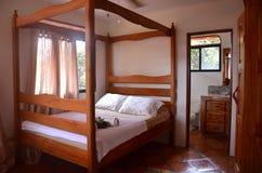 Cozy small bedroom at a retreat. Cute, cozy small bedroom at a retreat royalty free stock photo