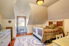Cozy small bedroom with vaulted ceiling Stock Photography