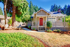 Cozy small house with outdoor rest area Royalty Free Stock Images