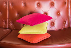 Cozy sofa with pillows. Living room interior and home decor concept Royalty Free Stock Images