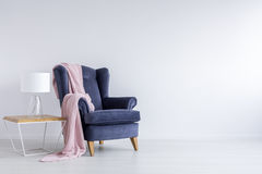 Cozy space for relax. In white living room with blue armchair royalty free stock photo