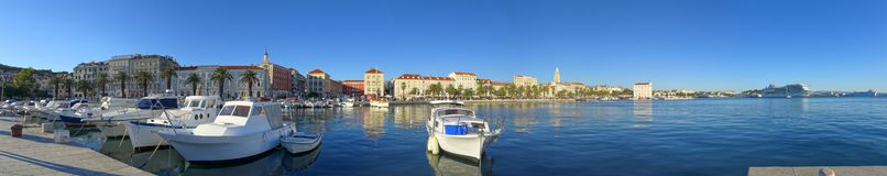 The cozy Split marina with the bustling Riva in the background royalty free stock image