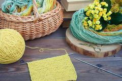 Cozy spring atmosphere with hand knitting process, DIY concept stock photography