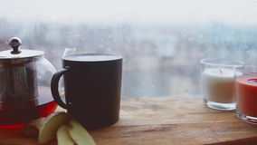 Cozy still life. Autumn weather, stormy and raining outside window. Cozy tea party and rain stock video footage