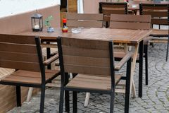 Cozy street restaurant. Tables and chairs in the street. Cozy street restaurant, Tables and chairs in the street royalty free stock photo