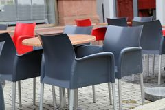Cozy street restaurant. Tables and chairs in the street. Cozy street restaurant, Tables and chairs in the street stock image
