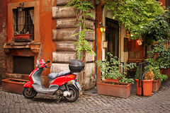 Cozy street in Rome. Motobike on a cozy street in Rome, Italy Royalty Free Stock Photo