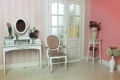 Cozy stylish vintage corner of the bedroom Stock Image