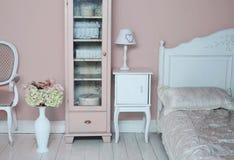 Cozy stylish vintage corner of the bedroom Stock Photos
